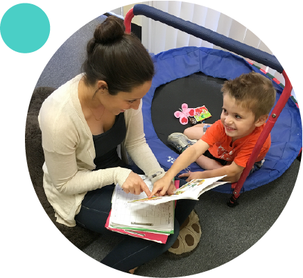 kara dodds careers page image of a speech therapist and a child looking at each other smiling